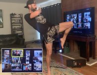 Kru Dave demonstrating a Muay THai knee to online students.